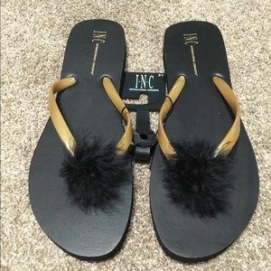 🆕INC black and gold flip flops